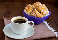 Crispy puff cookie with white chocolate and black coffee cup Royalty Free Stock Photo