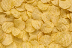 Crispy ribbed potato chips. Background Stock Images