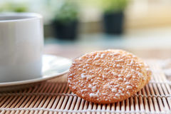 Crispy Rice Crackers with Hot cup of coffee on wooden table back Stock Photography