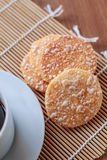 Crispy Rice Crackers with Hot cup of coffee on wooden table back Stock Image