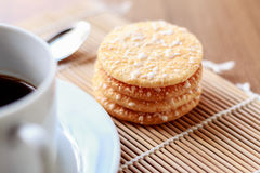 Crispy Rice Crackers with Hot cup of coffee on wooden table back Royalty Free Stock Photos