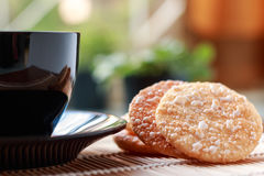 Crispy Rice Crackers with Hot cup of coffee on wooden table back Stock Photos