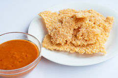 Crispy rice sheets eaten baked or fried. The crispy rice and curry is the breakfast  for every one Stock Photos