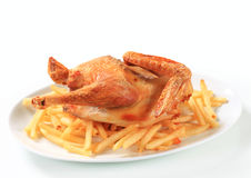 Crispy roast chicken with French fries Stock Photos
