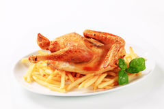 Crispy roast chicken with French fries Royalty Free Stock Photo