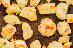 Crispy roast potatoes on silicone sheet Stock Images