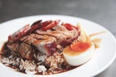 Crispy roasted belly pork chinese style and rice. Talat Noi, Bangkok, Thailand - Mar 19, 2012 : Crispy roasted belly pork chinese style and rice with boiled egg Royalty Free Stock Photo