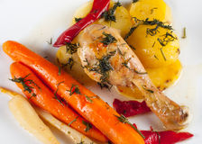 Crispy roasted chicken leg with vegetables Stock Image