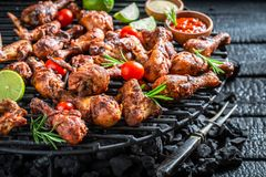 Crispy roasted chicken wings with sauces and lime Royalty Free Stock Image