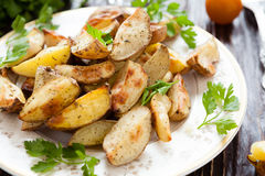 Crispy roasted potato wedges with skin Stock Photography