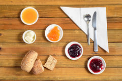 Crispy rolls with butter, apple and berry jam for breakfast Stock Image