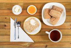 Crispy rolls with butter, apple and hot tea for breakfast Royalty Free Stock Photography
