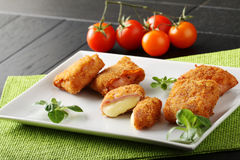 Crispy rolls of ham with cheese. Breaded with breadcrumbs and fried Royalty Free Stock Images