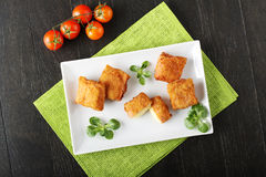 Crispy rolls of ham with cheese. Breaded with breadcrumbs and fried Stock Image
