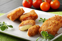 Crispy rolls of ham with cheese. Breaded with breadcrumbs and fried Royalty Free Stock Photos