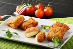 Crispy rolls of ham with cheese. Breaded with breadcrumbs and fried Stock Images