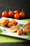 Crispy rolls of ham with cheese. Breaded with breadcrumbs and fried Stock Photo