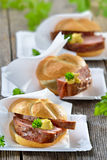 Crispy rolls with warm meat loaf Stock Images