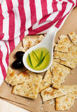Crispy rosemary and olive oil crackers on craft paper Royalty Free Stock Images