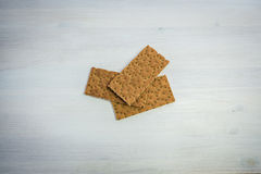Crispy Rye Bread Crackers low calories Gluten Free. Bread, onion garlic on the table Royalty Free Stock Images