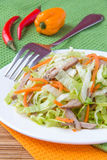Crispy salad with pork, korean carrots and lettuce Stock Image