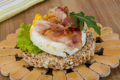 Crispy sandwich with egg and bacon Stock Photo