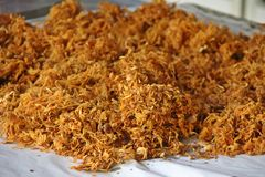 Crispy shredded pork before sell. Spread on the large dish to release palm oil Royalty Free Stock Image