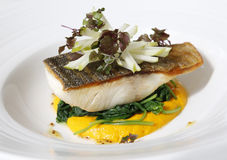 Crispy Skin Barramundi Fish with Spinach Royalty Free Stock Image