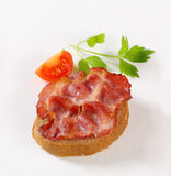 Crispy slice of pork meat on bread Royalty Free Stock Images