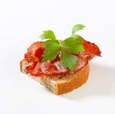 Crispy slice of pork meat on bread Stock Photo
