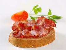 Crispy slice of pork meat on bread Stock Images