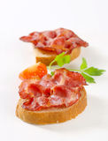 Crispy slices of pork meat on bread Royalty Free Stock Image