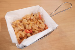 Crispy small fried shrimps served on wooden table Stock Images