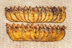 Crispy smoke dried ompok bimaculatus fish. Close up Crispy smoke dried ompok bimaculatus fish on bamboo threshing basket Stock Images
