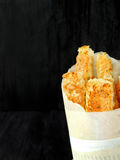 Crispy snacks in a paper bag Royalty Free Stock Photos