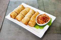 Crispy spring roll on white plate Royalty Free Stock Images