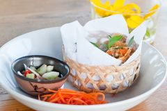 Crispy spring rolls on dish with vegetable.  Royalty Free Stock Photos