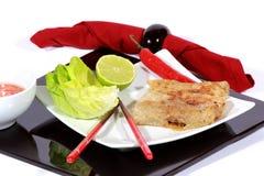 Crispy springrolls on dish with salad Royalty Free Stock Photo