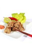 Crispy springrolls on dish with salad. Vietnamese dish on the white Royalty Free Stock Photo