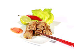 Crispy springrolls on dish with salad. Food on the white background Stock Images