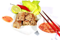 Crispy springrolls on dish with salad. On the white background Royalty Free Stock Image