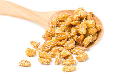 Crispy Sugared Nuts With Wooden Spoon. Crispy Sugared Nuts With Wooden Spoon Isolated On White stock photography