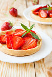 Crispy tartlet with sweet strawberry dessert Stock Image