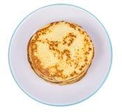 Crispy thin pancakes on plate, light background Stock Photos