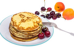 Crispy thin pancakes on plate, light background Royalty Free Stock Photography