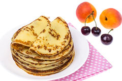 Crispy thin pancakes on plate, light background Stock Images