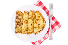 Crispy thin pancakes on plate, light background Royalty Free Stock Photo