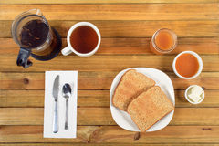 Crispy toast with butter, apple jelly and hot tea for breakfast Royalty Free Stock Photos