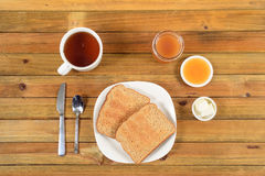 Crispy toast with butter, apple jelly and hot tea for breakfast Royalty Free Stock Image