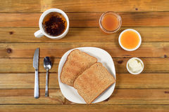 Crispy toast with butter, apple jelly and hot tea for breakfast Stock Photography